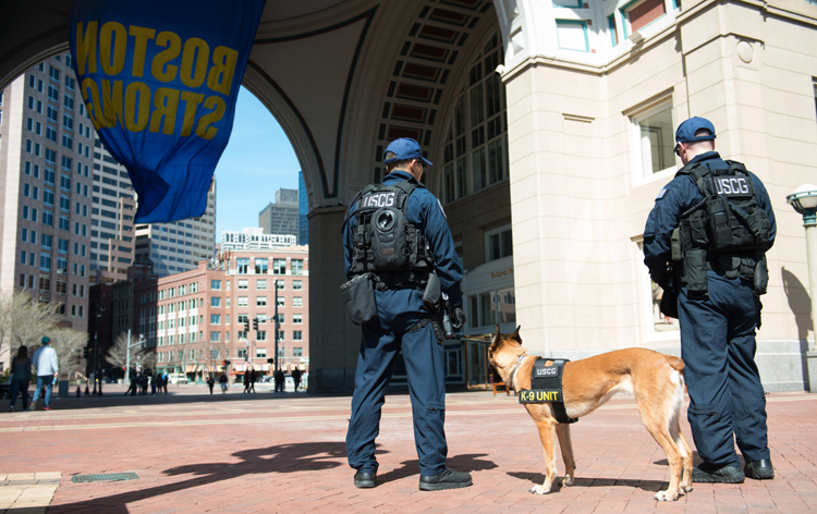 Petty Officers Craig Oravitz and Richard Barone patrol Boston Strong waterfront with Rruthie a specially trained Coast Guard dog, Sunday, April 17, 2016. The team is based out of New York and and is in Boston as part of an increased security presence for the Boston Marathon. (U.S. Coast Guard photo by Petty Officer 3rd Class Andrew Barresi)