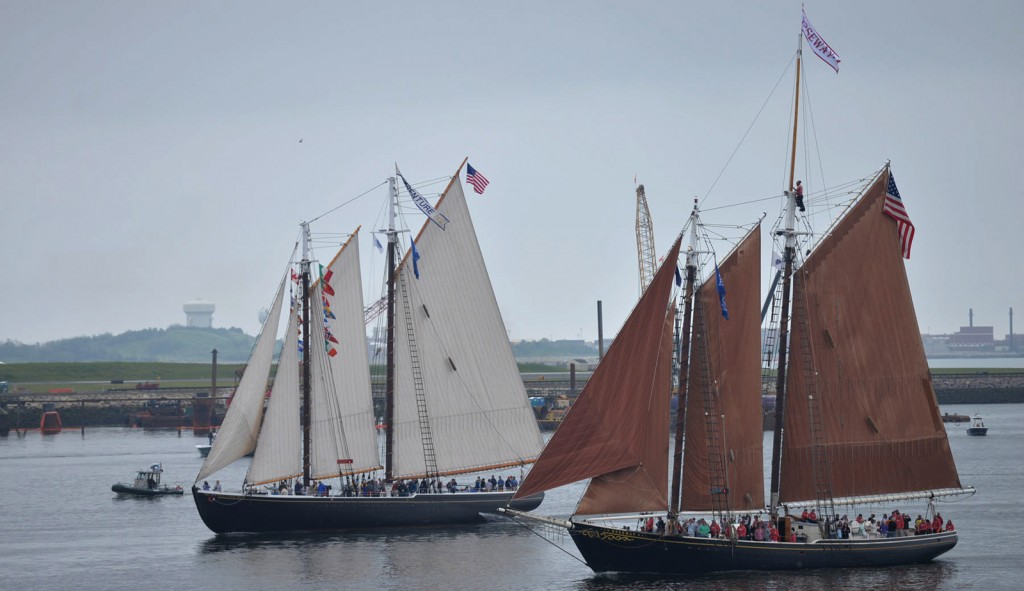 170617-N-ZU404-074 BOSTON (June 17, 2017) Schooner Adventure (left), homeported in Gloucester, Mass., and schooner Roseway (right), homeported in Boston, sail by USS Whidbey Island (LSD 41) during the Grand Parade of Sails for Sail Boston 2017, June 17. Whidbey Island and more than 50 Tall Ships from around the world are participating in Sail Boston 2017, a five-day maritime festival in the Boston Harbor. The event gives Bostonians an opportunity to see firsthand the latest capabilities of today's sea services, as well as experience maritime history - both past and present. (U.S. Navy photo by Mass Communication Specialist 2nd Class Jordyn Diomede/Released)
