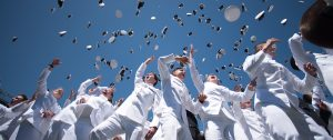 U.S. Naval Academy Grads throw their hats in the air